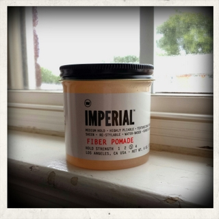 Imperial Barber Products Fiber Pomade jar on white surface